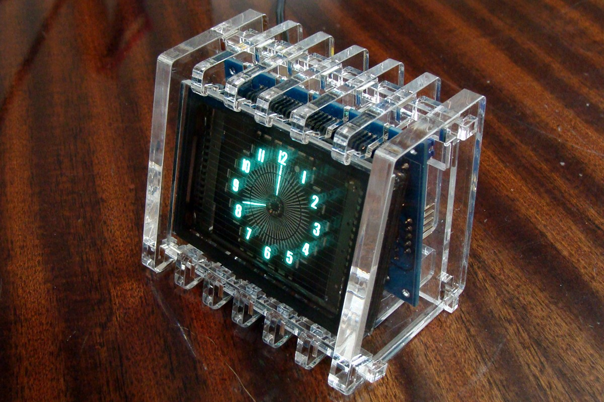 VFD ROUND CLOCK IN CLEAR ACRYLIC CASE